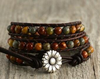 Earth tone beaded bracelet. Natural triple wrap leather bracelet. Bohemian chic wrap