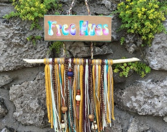 Free Hugs wood sign with yarn fringe