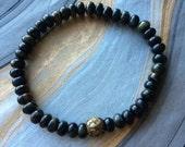Unisex Blue Tiger Eye Rondelle Stretch Bracelet with Gold Prayer Bead