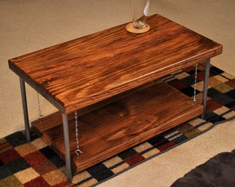 Double layered coffee table, suspended shelf