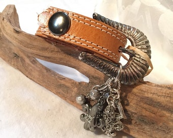 Leather cuff with buckle and charms