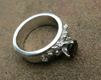 Garnet and fine silver ring.