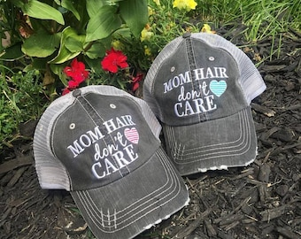 Hats { Mom hair don't care } Pink or teal heart.