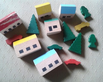 Vintage wooden houses cars and trees