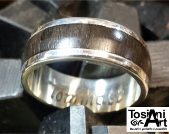 Silver ring with ebony wood.