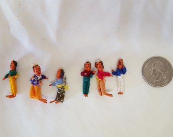 Six small worry dolls