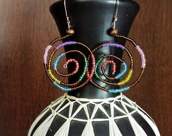 Colourful seed bead swirl earrings.