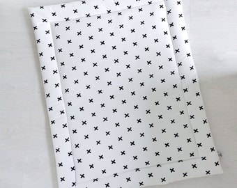 White baby playmat with cross print