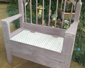 Hand built storage bench made from old bed