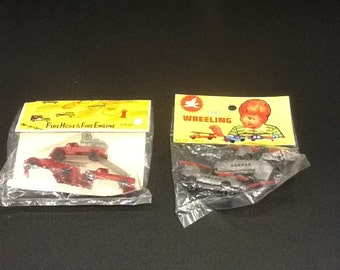 1960's dime store free wheeling helicopter and fire engine  toy set