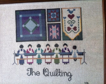 A Completed Framed Needlepoint Titled The Quilting Signed SDL 87