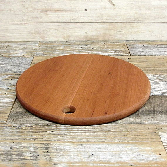 sale price reduced wooden cutting board round cherry wood. Black Bedroom Furniture Sets. Home Design Ideas