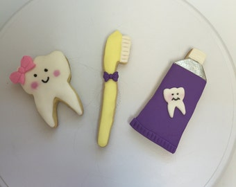 Tooth, toothbrush , and toothpaste cookies