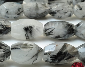 A grade 15 inches of Natural Black Rutilated Quartz faceted nugget beads in 13-15 width X 20-25mm length