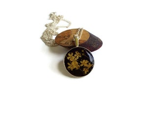 Clear resin necklace with real dried flowers