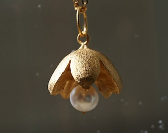 Sterling silver pendant flower shape with white pearl    movable rings like bells natural form shimmering textured surface wedding jewelry