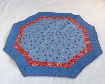 octagon table runner / center piece made from ladybug and white daisy flower on blue cotton fabric with blue and red coordinating fabrics