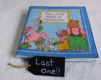 "cloth book titled "" The Little Book of Opposites"" for babies and toddlers"