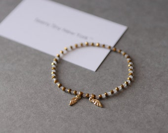 Gold & Light Pink Beads Bracelet with Tiny  Angel Wings