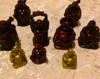 Lot of Nine (9) Buddha Staues