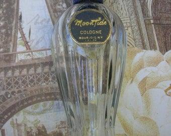 Empty bottle of MoonTide cologne by Bourjois. 1 fl. oz. size, 1960s fragrance.