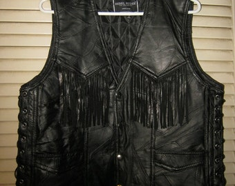 """REDUCED..LOWEST PRICE.....Black Leather Fringed Vest, Rebel Ryder Size """"S"""", Quilted Lining, Laced Sides, Pieced Leather"""