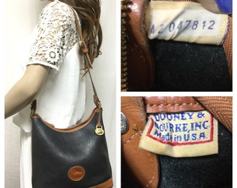 Free Ship Dooney and Bourke All Weather Leather Purse Black and British Tan Shoulder Bag