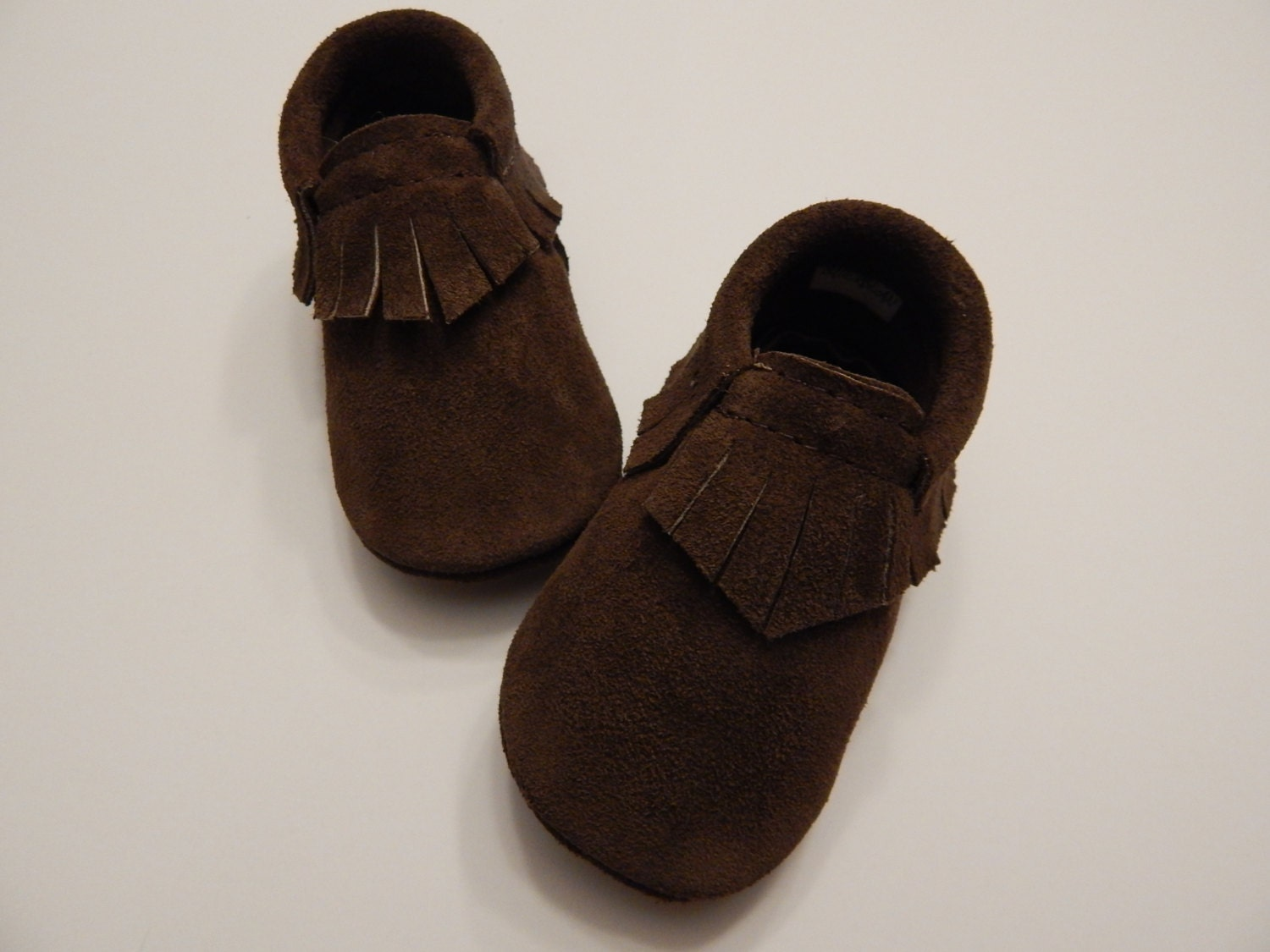 We hand-picked this because: These adorable soft sole leather baby shoes are made of top grade, genuine leather with non-slip gommino soles. Easy to take on and off, they are comfy and colorful too!