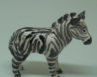 Miniature porcelain zebra sculpture