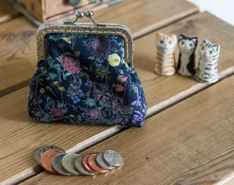 Coin purse made with Liberty Tana Lawn in the print: 'Wild Flowers', a sunny yellow cotton lining, and hand stitched silver metal frame