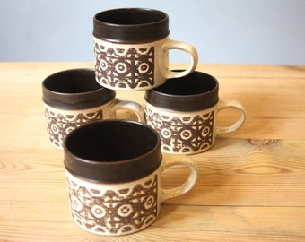 Four Denby Stoneware mugs, 1970s, with a geometric pattern.