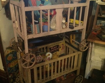 vintage 20s 30s baby / doll crib wooden pink or yellow wood shabby chic wheels moving panel use for dolls