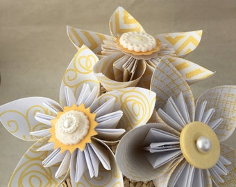 Country paper flower arrangement in a box. Kusudama roses in yellow with raffia trim.