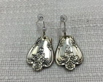 Silver spoon earrings.