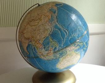 Vintage Globe. Rand McNally International Globe, 1978-1982. 12 inch Diameter. Light Blue globe with brass toned base.