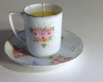 Vintage pink and white beeswax teacup candle
