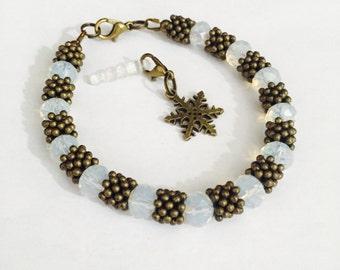 Opal glass bead and bronze snowflake bracelet,October birthstone bracelet,gift,present,gift for women,Bronze jewellery