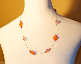 Single strand orange and pink necklace