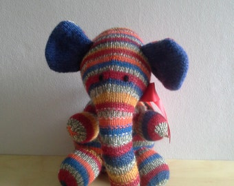 Bright multi elephant with blue ears