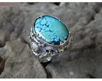 Silver flower ring motif with turqouis stone
