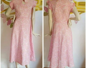 50% off with coupon SaleAGoGo  A Handmade Reproduction 1940s keyhole dress made with 40s fabric.