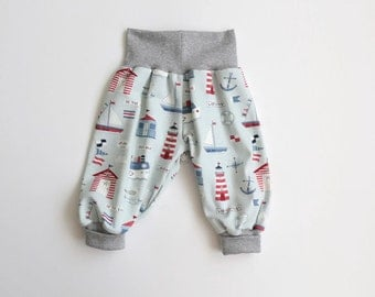 Baby harem pants. Light blue bubble pants with lighthouses, boats, fish. Slouchy infant pants with gray grey fold over waistband and cuffs.
