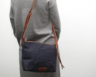 messenger bag , waxed Cotton canvas,navy blue color,  with leather handles,metalic ykk zip,hand wax