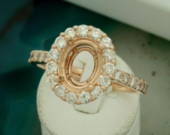 14 karat rose gold oval cut diamond semi mount engagement ring set with 0.86 carats in fine brilliant round diamonds. Made in the USA.
