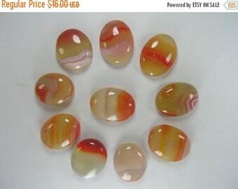 10% Off Orange Shaded Onyx Oval Cabochons (10 Stones)
