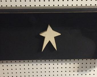 Primitive shelf with star
