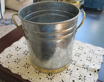 Small galvanized tub with gold colored band and handles