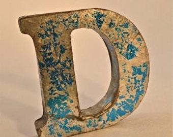 A fantastic vintage style metal 3D blue letter D
