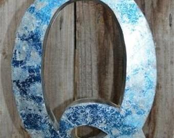 Medium vintage style 3D blue letter Q