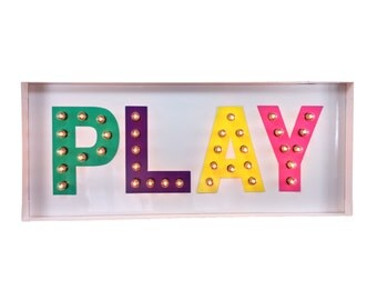 PLAY marquee sign